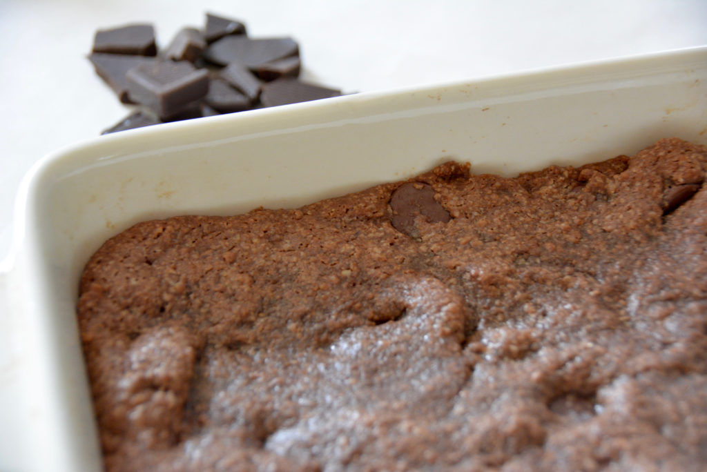 brownies in pan with chocolate chunks