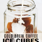 milk being poured into a glass of cold brew coffee with a white background