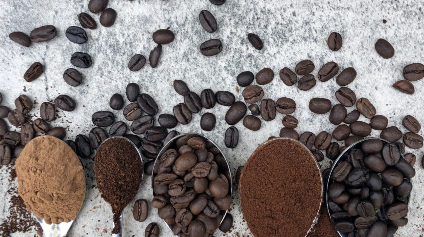 espresso beans on spoons