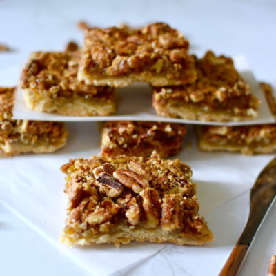 Pecan pie bars stack with butter knife