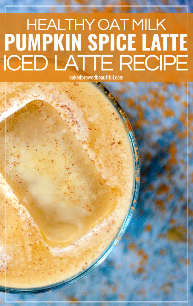 from top - view of pumpkin spice latte in a high ball glass with a blue background a small pumpkin and two ice cubes in the latte