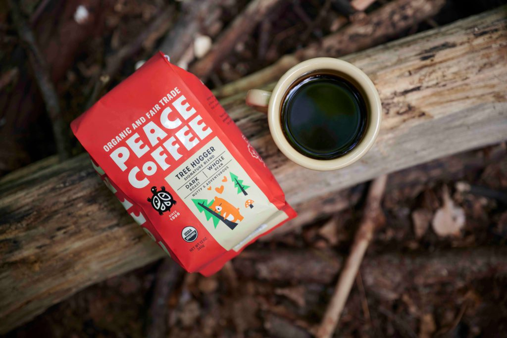 peace coffee bag on wood background