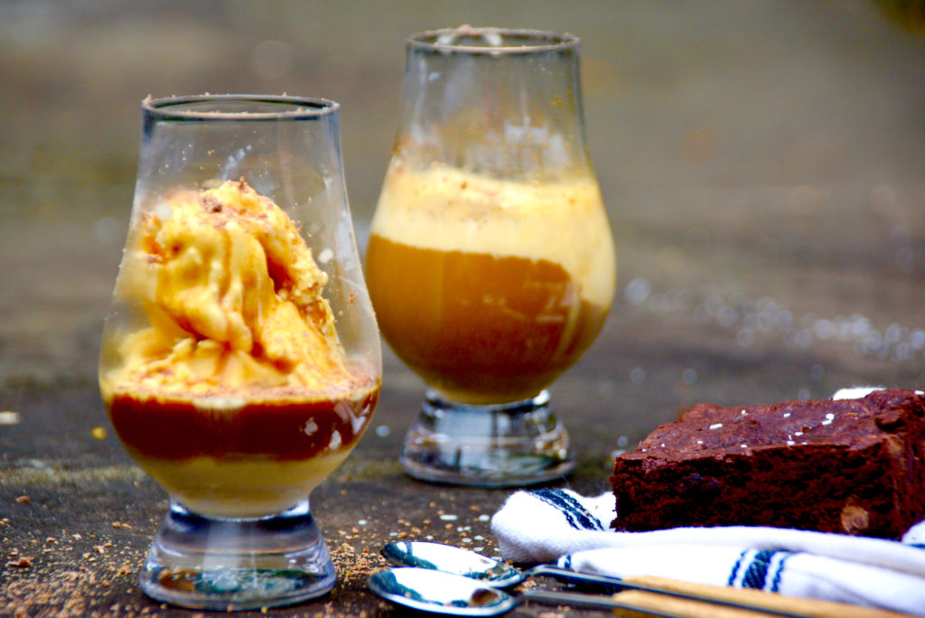 two affogatos on pavement outside with vanilla ice cream and espresso