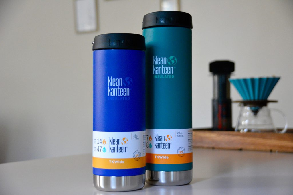 one blue and one teal klean kanteen insulated travel mugs on a counter