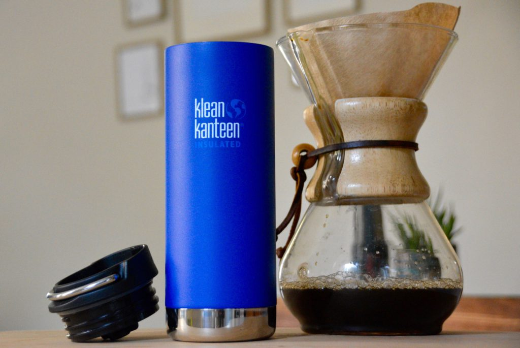 blue klean kanteen thermos next to a chemex with coffee