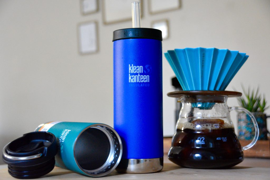 one blue and one teal klean kanteen insulated travel mugs and an origami dripper
