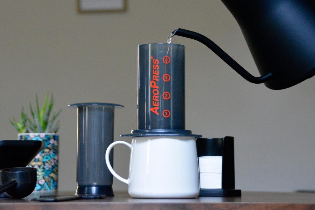 gooseneck kettle pours water into AeroPRess
