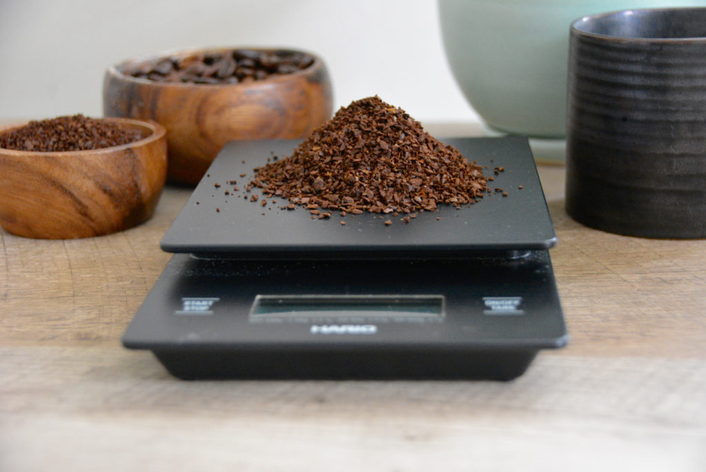coffee scale with coffee grounds on top