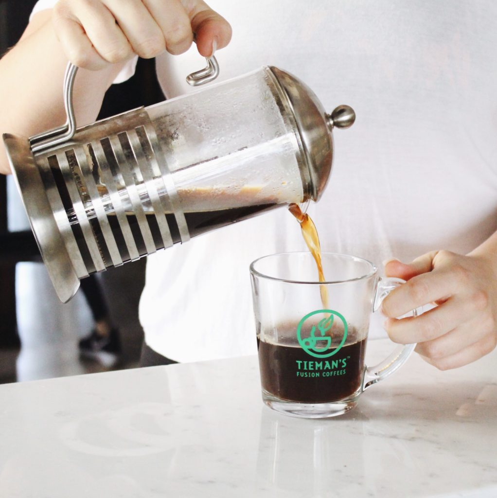 Tieman's coffee being poured into glass cup