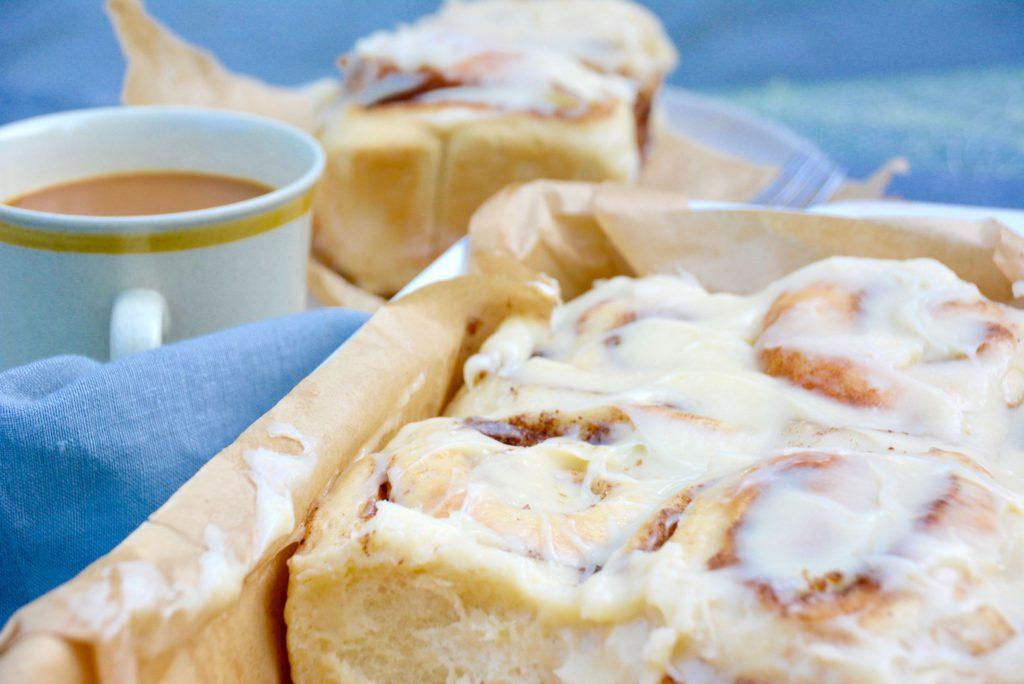 cinnamon rolls in baking pan with coffee
