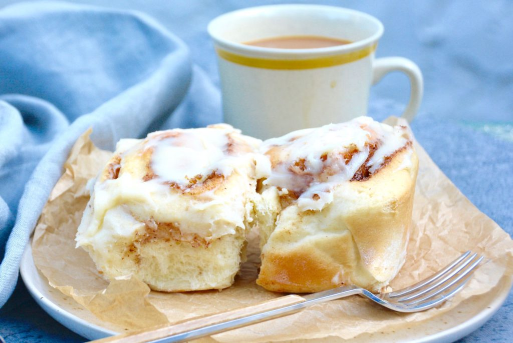cinnamon rolls on a plate with coffee