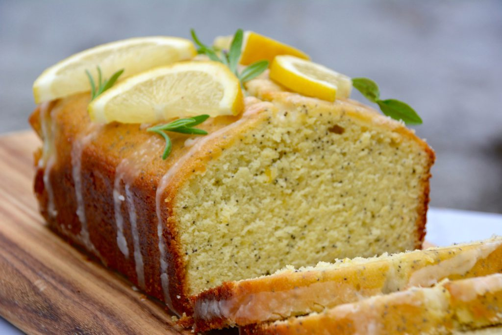lemon poppy seed loaf cake on wood server