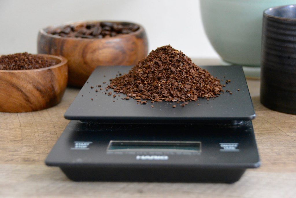 coffee hario scale with coffee grounds on top