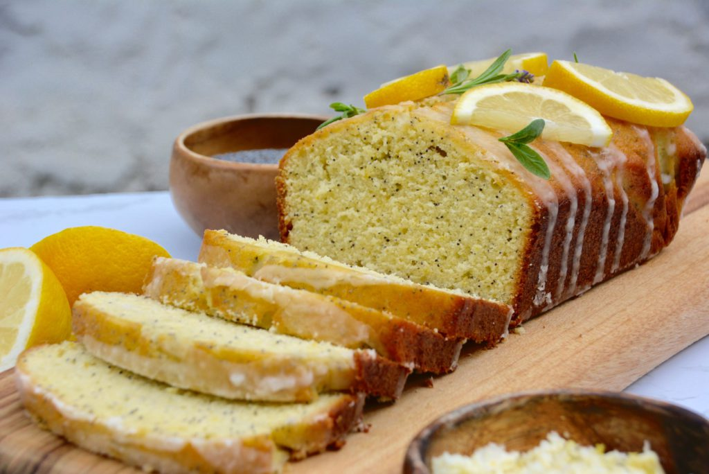 lemon poppy seed loaf cake on wood board