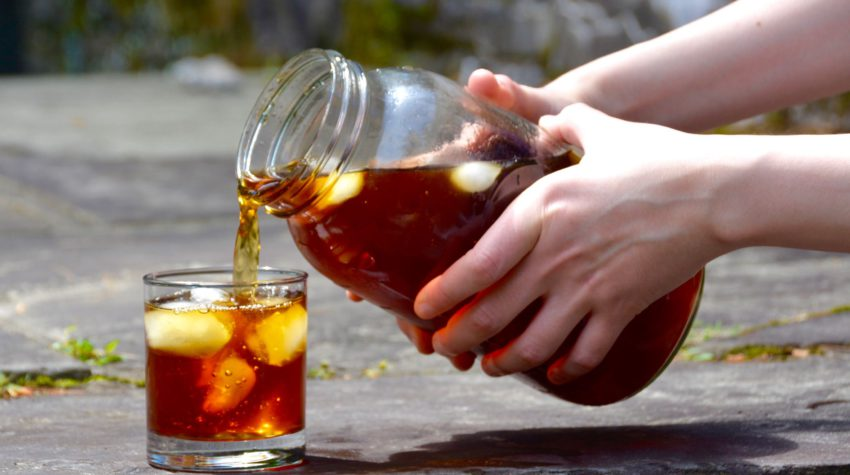 pouring cold brew into a glass