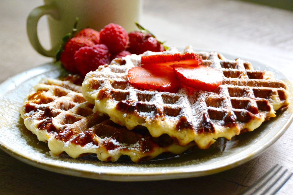 Liege Belgian waffles on a plate and a cup of coffee