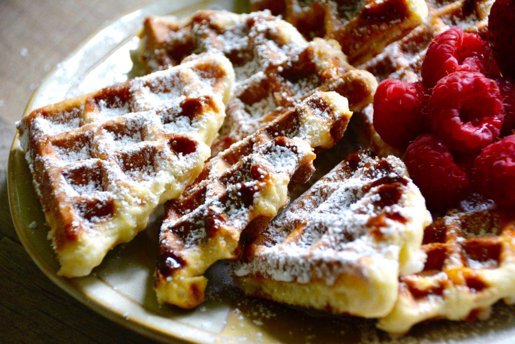 cut Liege Belgian waffles with raspberries