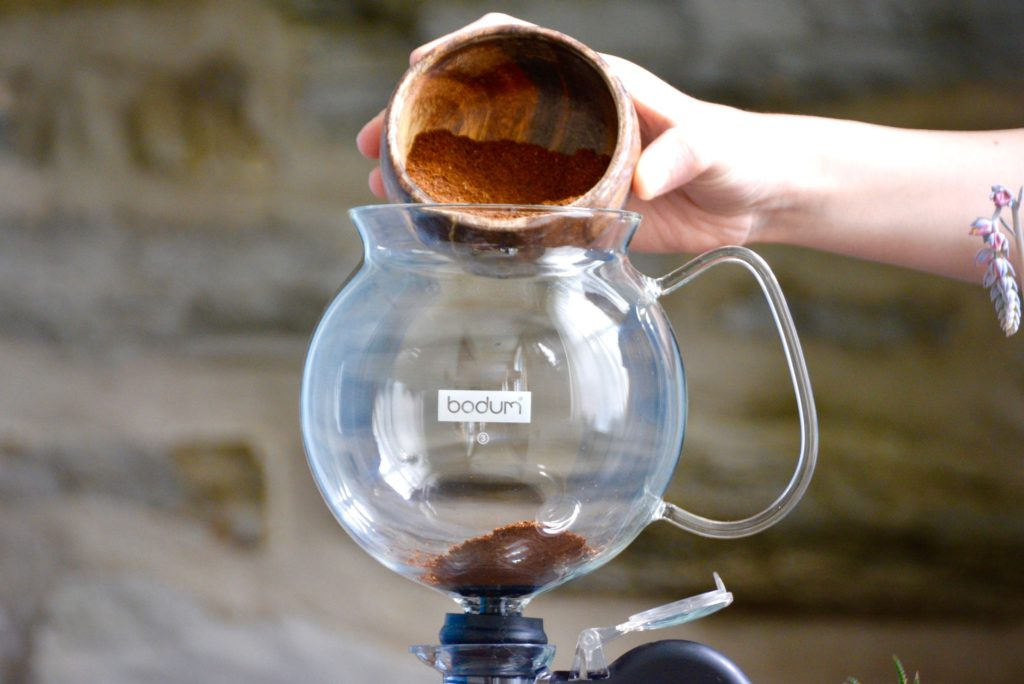 coffee grounds inside of a siphon brewer
