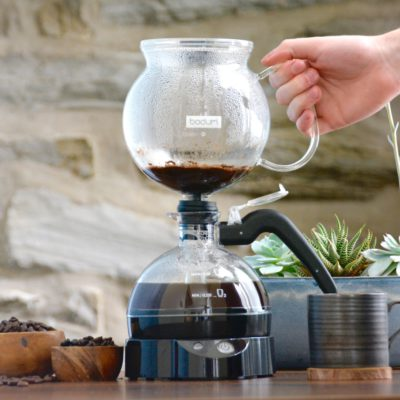siphon coffee maker in use