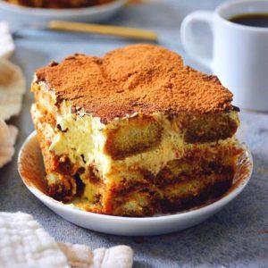 tiramisu on a plate with coffee