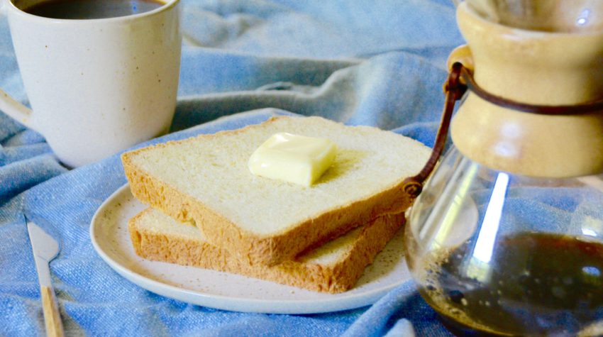 white bread with chemex and cup of coffee on a blue background